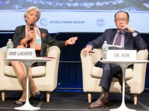 IMF Managing Director Christine Lagarde and World Bank President Jim Yong Kim at the IMF and World Bank semi-annual meeting. This October's meeting coincides with the OECD's optimistic projection for the world's economy