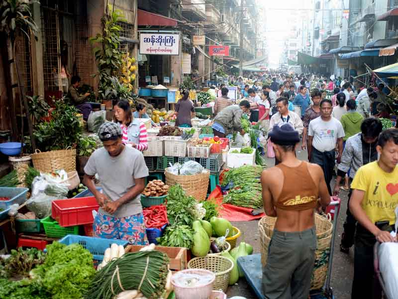 A market In Yangon, Myanmar. Myanmar is still a cash-based society. With the implementation of automatic cash services, CB Bank is hoping to update Myanmar's financial sector
