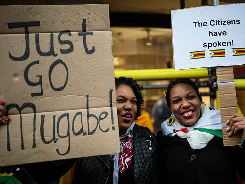 Protesters call for Robert Mugabe's resignation as prime minister of Zimbabwe in November 2017. Mugabe resigned from his position after 37 years in power