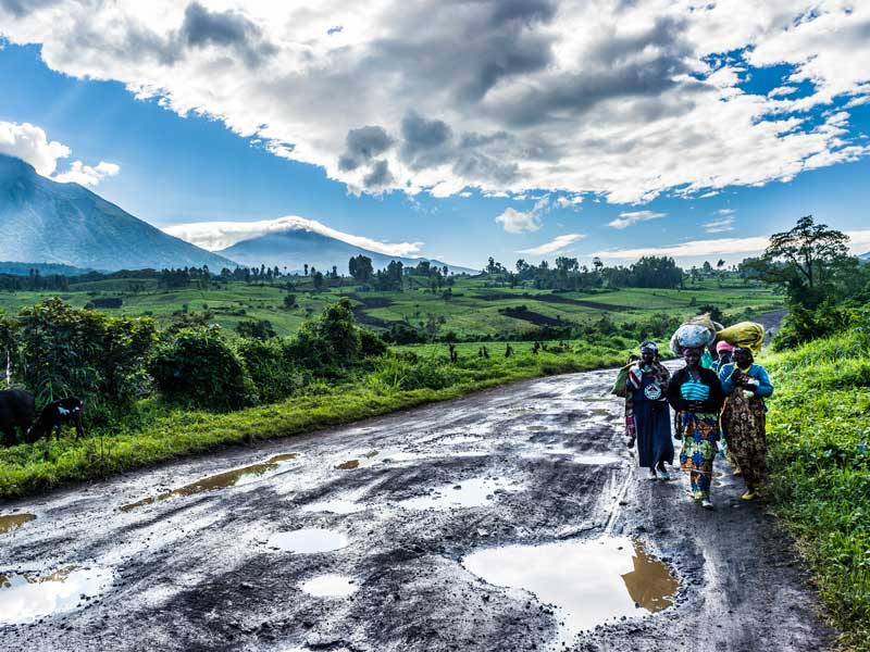 Local women carrying goods on poorly maintained roads, Democratic Republic of the Congo. The poor infrastructure across Africa has a negative impact on the continent's economic growth