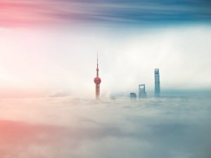 Commercial buildings immersed in fog in Shanghai, China. Despite being the world's largest emitter of greenhouse gas, China is now leading the charge for green energy development