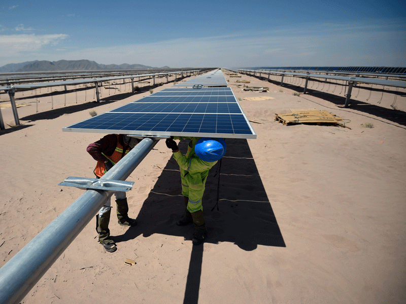 Workers install solar panels at the Villanueva solar photovoltaic power plant near Villanueva, Mexico. The country's renewable energy policy has become highly advanced in recent years