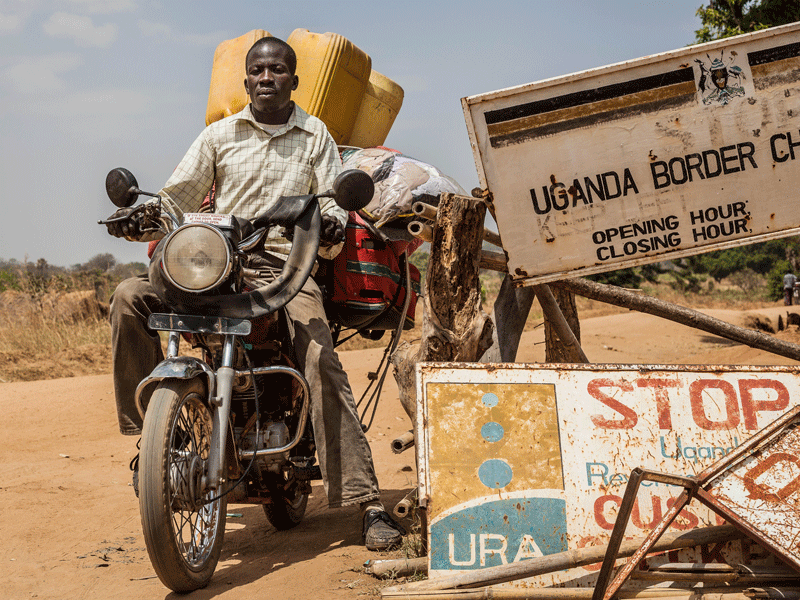 A man crosses the border in Moyo, Uganda. Sub-Saharan Africa stands out as the region that is in most need of the humanitarian aid that these innovative investment tools aim to deliver