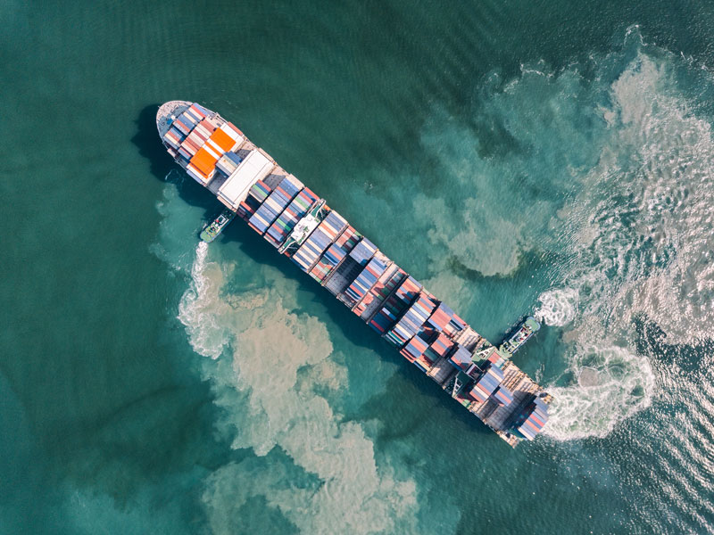 An aerial view of an unknown cargo ship off the coast of Guangdong, China. The two Chinese shipping firms have had their US assets' frozen, alongside other punitive measures