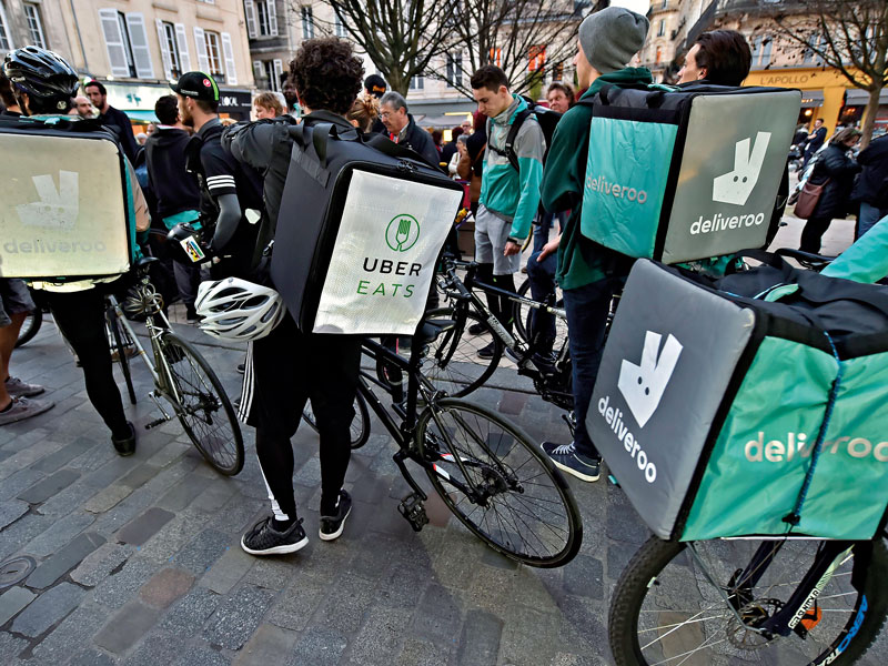 Delivery workers take part in a demonstration in Bordeaux, France