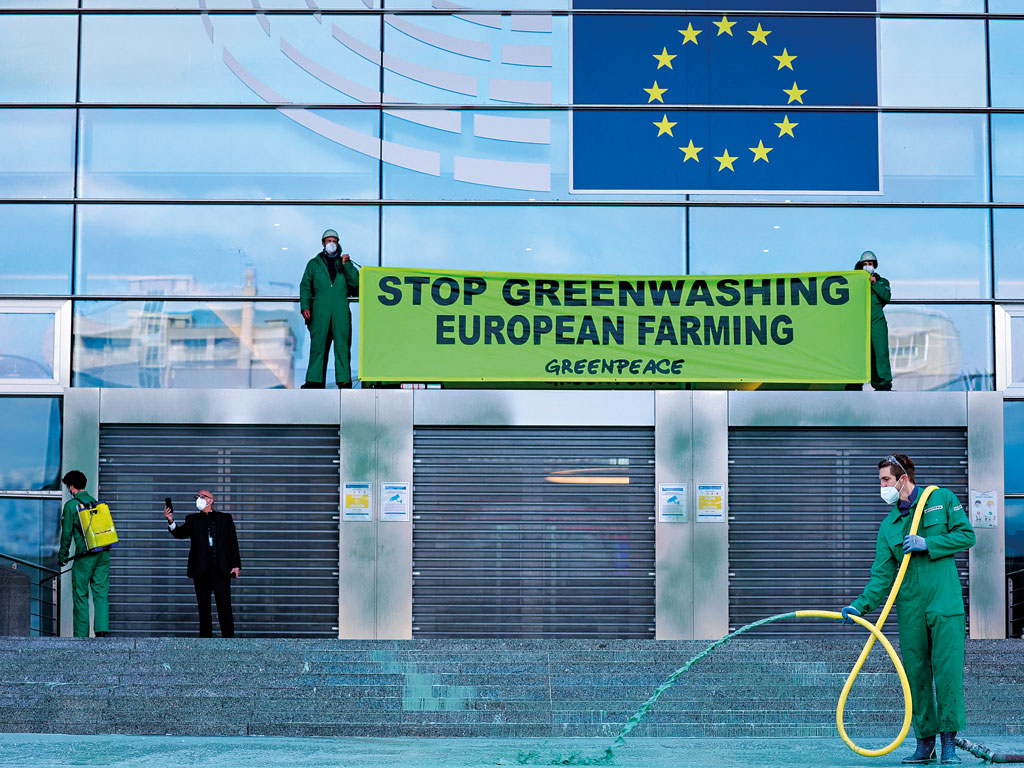 A Greenpeace 'greenwashing' protest at the European Parliament in Brussels, Belgium
